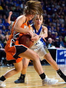 BANGOR, Maine -- 02/18/2017 -- Winslow's Sarah Guimond (left) battles for a loose ball with Hermon's Alex Allain during their Class B girls basketball quarterfinal game at the Cross Insurance Center in Bangor Saturday. Ashley L. Conti | BDN