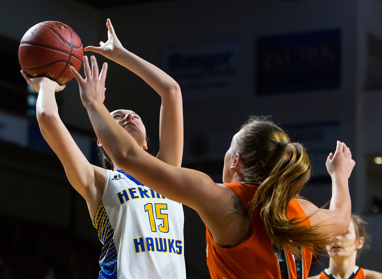 BANGOR, Maine -- 02/18/2017 -- Hermon's Emi Higgins (left) tries for two around Winslow's Heather Kervin during their Class B girls basketball quarterfinal game at the Cross Insurance Center in Bangor Saturday. Ashley L. Conti   BDN