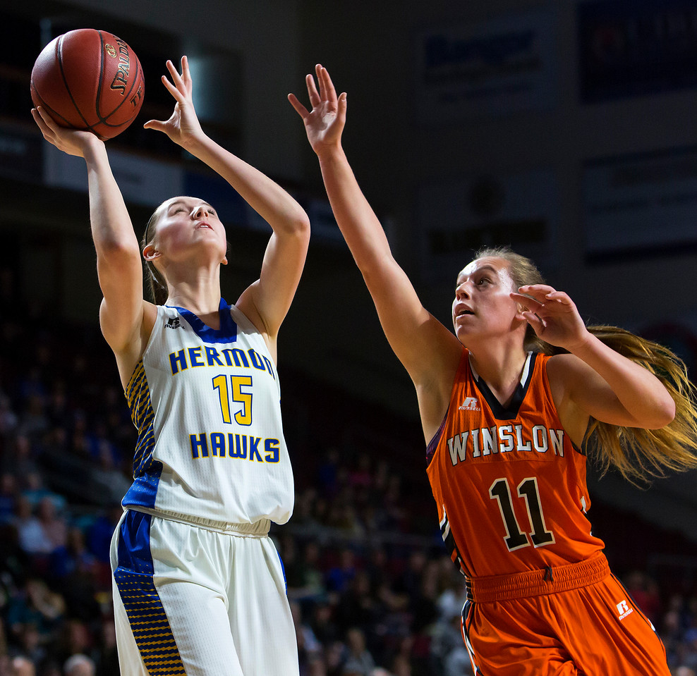 BANGOR, Maine -- 02/18/2017 -- Hermon's Emi Higgins (left) puts up a shot past Winslow's Heather Kervin during their Class B girls basketball quarterfinal game at the Cross Insurance Center in Bangor Saturday. Ashley L. Conti   BDN