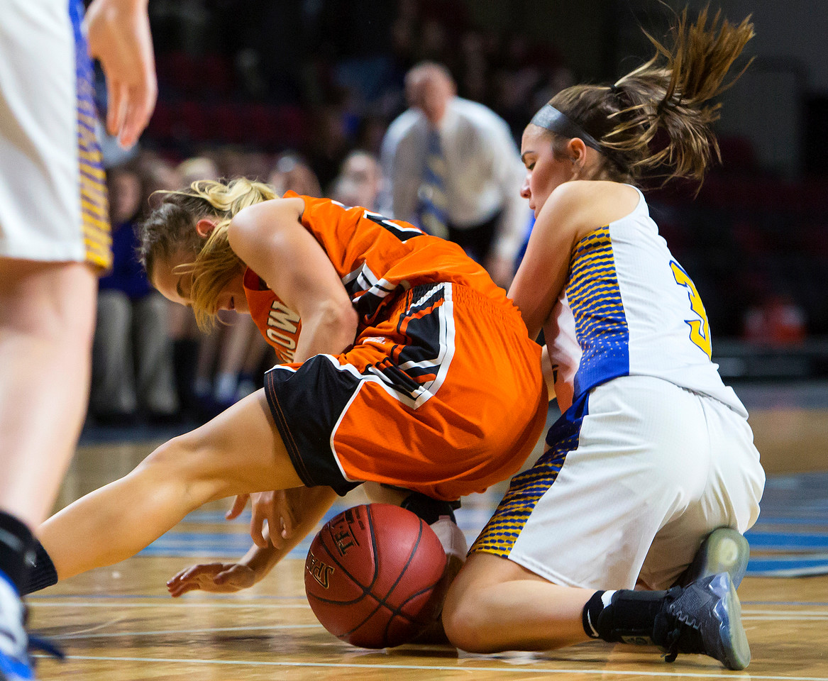 BANGOR, Maine -- 02/18/2017 -- Winslow's Ciara LeClair (left) battles for a loose ball with Hermon's Alex Allain during their Class B girls basketball quarterfinal game at the Cross Insurance Center in Bangor Saturday. Ashley L. Conti | BDN