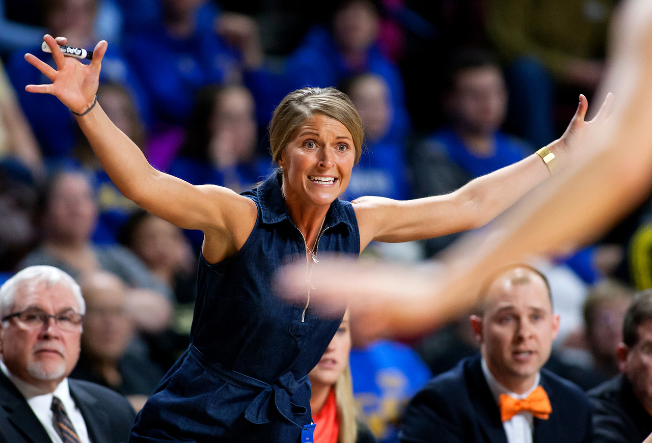 BANGOR, Maine -- 02/18/2017 -- Winslow head coach Lindsey Withee yells instructions to her team during their Class B girls basketball quarterfinal game against Hermon at the Cross Insurance Center in Bangor Saturday. Ashley L. Conti | BDN