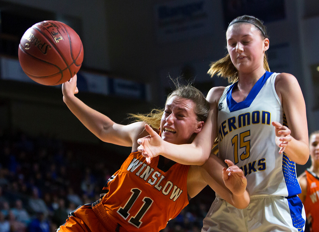 BANGOR, Maine -- 02/18/2017 -- Winslow's Heather Kervin (left) battles for a rebound with Hermon's Emi Higgins during their Class B girls basketball quarterfinal game at the Cross Insurance Center in Bangor Saturday. Ashley L. Conti | BDN