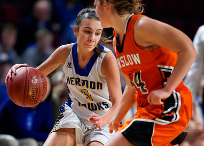 BANGOR, Maine -- 02/18/2017 -- Hermon's Alex Allain (left) cuts around Winslow's Weslee Littlefield during their Class B girls basketball quarterfinal game at the Cross Insurance Center in Bangor Saturday. Ashley L. Conti | BDN