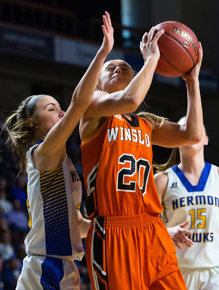 BANGOR, Maine -- 02/18/2017 -- Winslow's Ciara LeClair (right) goes up for two against Hermon's Brooke Cowan during their Class B girls basketball quarterfinal game at the Cross Insurance Center in Bangor Saturday. Ashley L. Conti   BDN