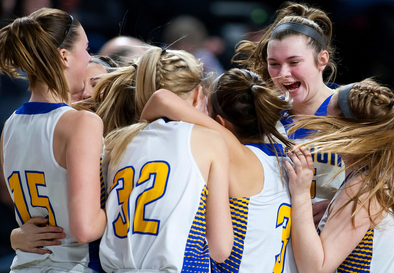 BANGOR, Maine -- 02/18/2017 -- Hermon celebrates after defeating Winslow during their Class B girls basketball quarterfinal game at the Cross Insurance Center in Bangor Saturday. Ashley L. Conti | BDN