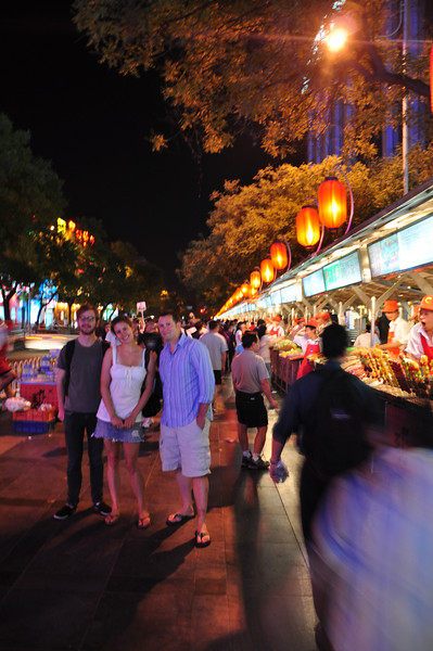 Here's Jack, Jessie, and Matt at the east end of the Night Market.  You can see the rows of stalls on the right stretching off into the distance...
