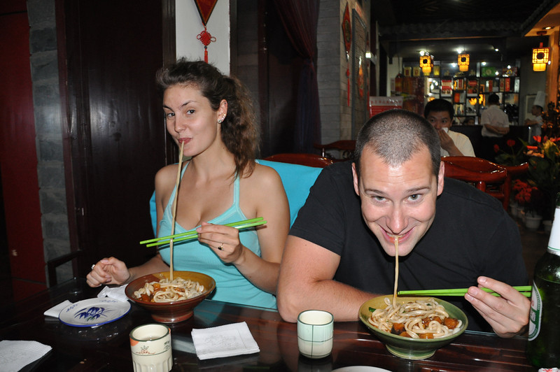 Dinner time!  Off to a restaurant that specializes in serving bowls containing one single noodle.  One single, very, very long noodle.  The tradition is to eat as much of the noodle without it breaking as you can; the more you can eat before the noodle breaks, the longer you will live.  I'm not huge on noodles, personally, but Matt and Jessie love them.  Here they are having a contest to see who can eat more noodle before it breaks...