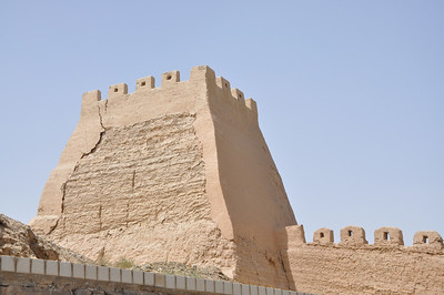 This looks like it was an original tower on the wall; its outside and top have been reconstructed.