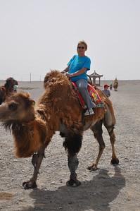 Diane takes a turn on camelback.