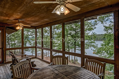 Back screened porch with view of lake