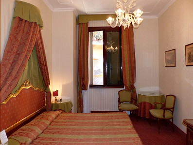 Hotel Room at Hotel Kette, Venice. Looking out of the window you look down into one of the smaller canals and see the gondolas pass by.