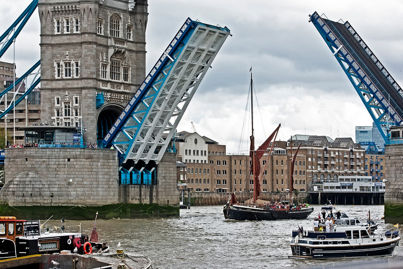 Tower Bridge with the drawbridge raised for a Thames Barge