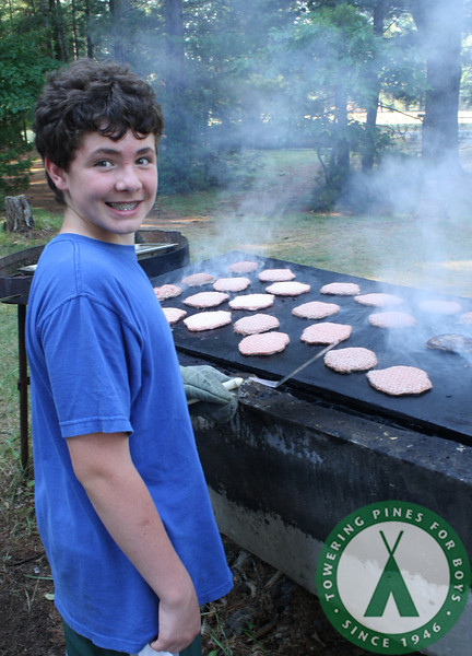 C8 cooks burgers for camp