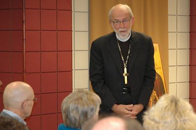 Presiding Bishop Mark S. Hanson listens as a participant reponds.