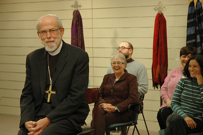 Bishop Hanson listens to the exchange.