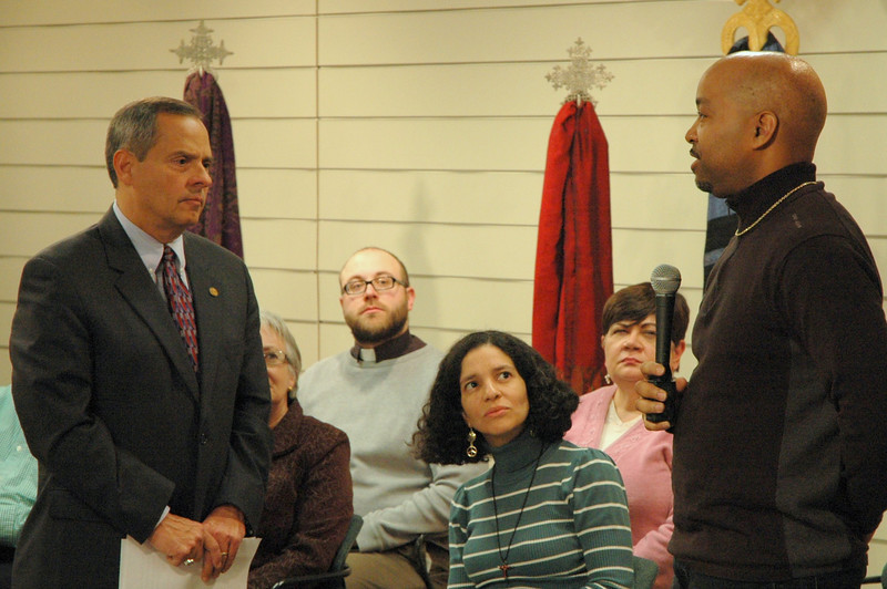 Vice president Carlos Pena listens as an ELCA member asks a question.