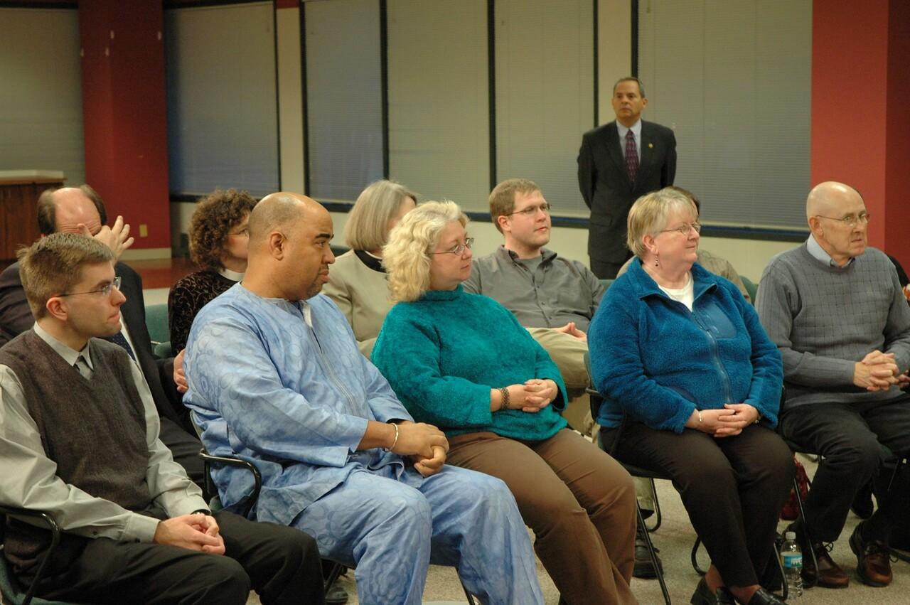 ELCA members listen to Bishop Hanson's response as vice president Carlos Pena looks on.