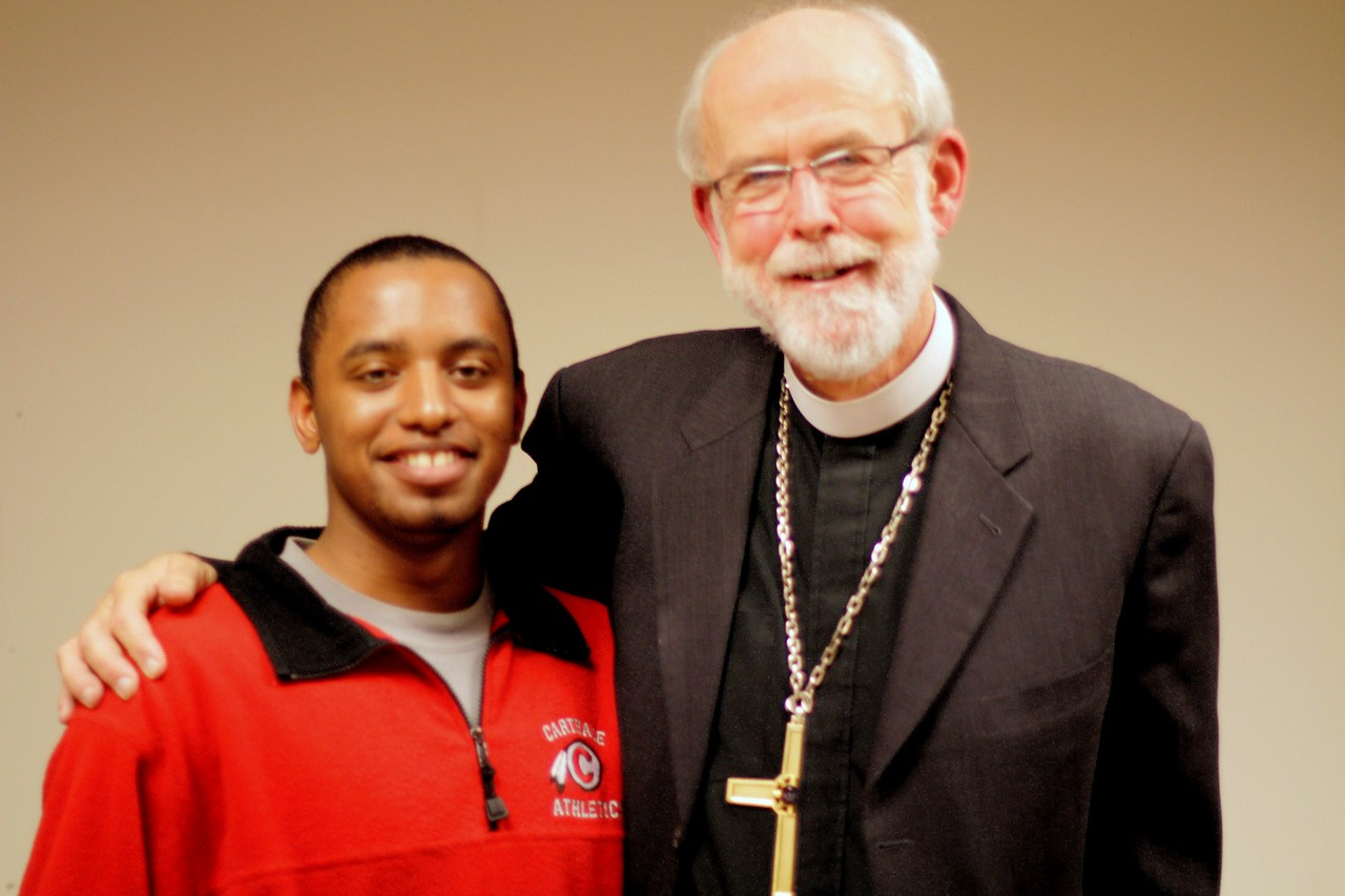 Emerson Murphy, member of Reformation Lutheran Church, Chicago, and student at ELCA's Carthage College, with ELCA Presiding Bishop Mark S. Hanson.  November 21, 2010 Online Town Hall Forum.