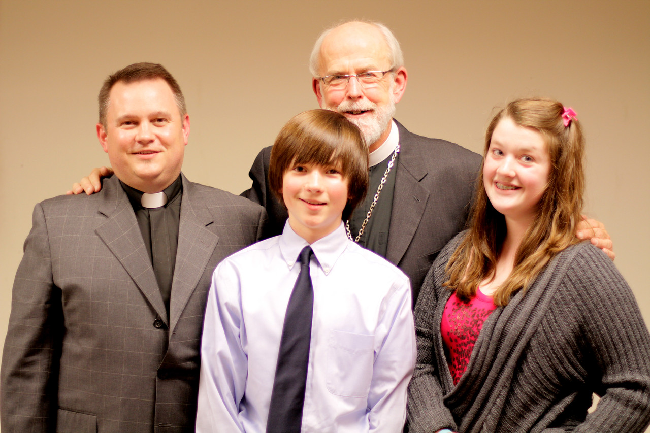 Pr. Ben Bergren and family join Bishop Hanson at the Town Hall Forum.