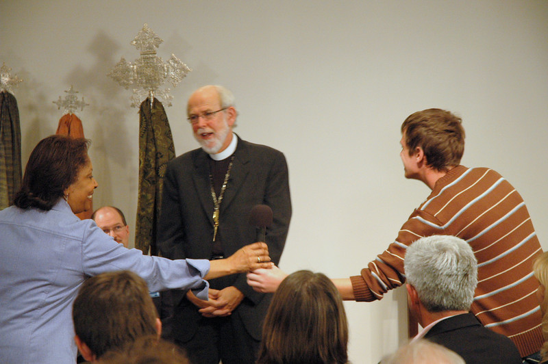 Ty Dahnke, from Holy Cross Lutheran Church in Libertville, IL passes the microphone back to host Pastor Wyvetta Bullock, after asking Presiding Bishop Mark Hanson if he ever thought he was going to be bishop.  November 21, 2010 ELCA Online Town Hall Forum.