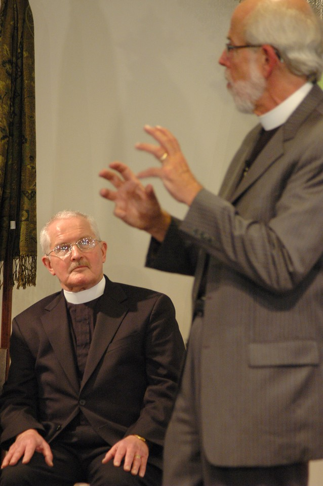 The Rev. David Langseth listens to Presiding Bishop Mark S. Hanson as he answers his question.