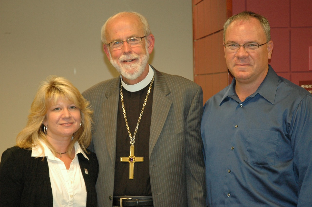 Presiding Bishop Mark S. Hanson surrounded by Chris Chippas and Anthony Riani