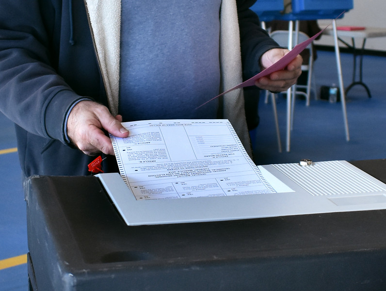 HOLLY PELCZYNSKI - BENNINGTON BANNER Voters in Bennington hand in their ballot for the Annual MAU & BSD decisions  as well a vote on whether to elect a mayor for the town of Bennington on Tuesday March 6, 2018