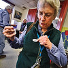 "KRISTOPHER RADDER - BRATTLEBORO REFORMER<br /> Barbara Woods, of Brattleboro, puts on a ""I Voted"" sticker after casting her ballot on March 6, 2018."