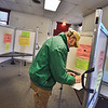 KRISTOPHER RADDER - BRATTLEBORO REFORMER<br /> Tim Mayo, of Brattleboro, fills out his ballot at the Municipal Building on March 6, 2018.