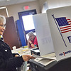 KRISTOPHER RADDER - BRATTLEBORO REFORMER<br /> Frances E Kirchner, of Wilmington, submits her ballot at Twin Valley Elementary, in Wilmington, on Tuesday, March 6, 2018.