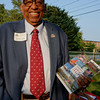 """Former Town Council President Harold Tobey holds a copy of """"Barnstable @ 375"""""""