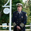 Former West Barnstable Fire Chief John Jenkins singing the National Anthem.