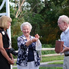 Former Town Councilor and OSB 125th Birthday Committee member June Daley receives a gift from Audrey and John Loughnane