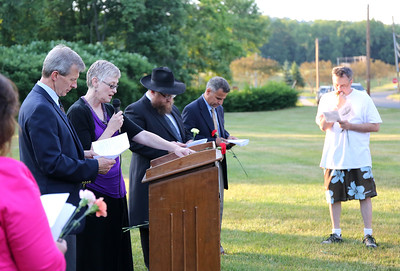 The Rev. James Wheeler, of Collinsville Congregational and Rev. Amy Johnson, of Canton Community Baptist, read a Litany for Violence Prevention.  Photo by John Fitts