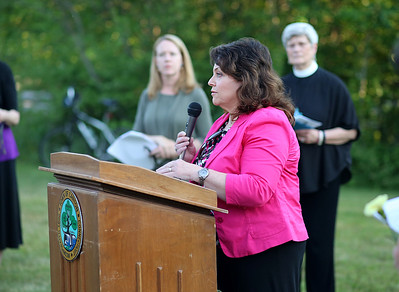 The Rev. Brenda Pelc-Faszca, interim past of First Congregational Church of Canton Center, speaks at the event.  Photo by John Fitts