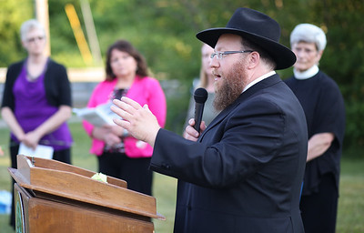 Rabbi Mendel Samuels, rabbi of Chabad of the Farmington Valley, read Deuteronomy 6:4-9 in Hebrew and English.   Photo by John Fitts