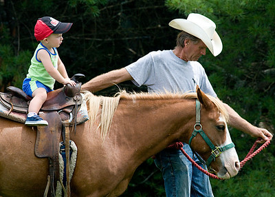 All of a sudden he started looking at the cowboy leading the horse. I bet he asked for a cowboy hat later on.