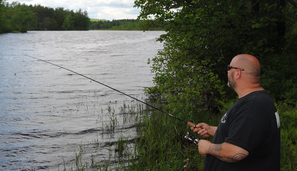 . NASHOBA VALLEY VOICE/ANNE O\'CONNOR When town officials think about how to attract and retain millennials, a vibrant street scene, affordable work space, transportation and recreation come to mind. Ben McGinnis of Lunenburg fishes at the Harbor Pond in Townsend. Sometimes he prefers another spot along the Squannacook River.