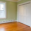 Front bedroom (second floor). Cherry flooring, cast iron baseboard, large closet.  Two more windows face the street.