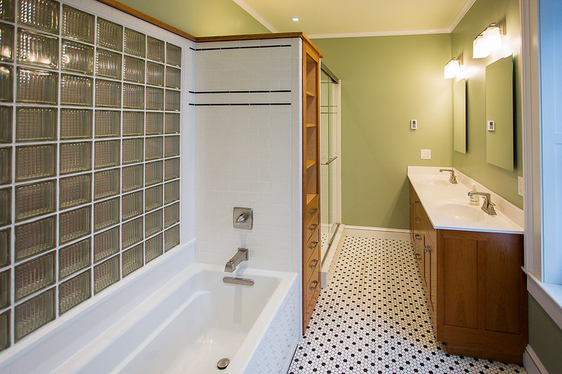 Master bath with oversized soaking tub, heated tile floor, custom cherry cabinets and glass door shower.