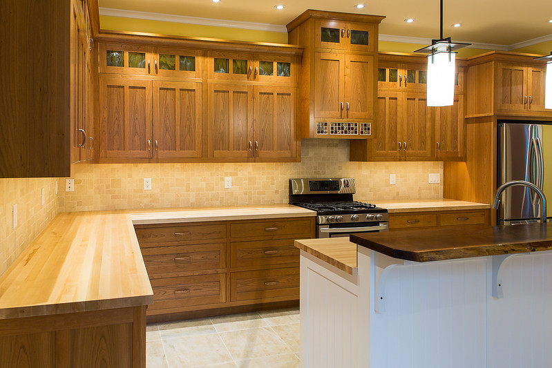 Maple butcher block counter tops, cherry cabinets.