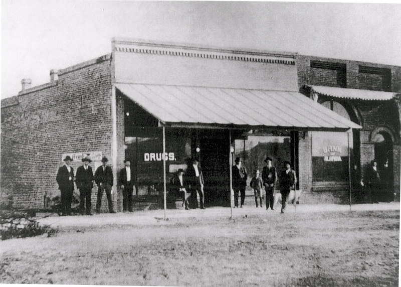 Street Scene_circa 1910_Bank of Alapaha_Drug Store<br /> <br /> The Berrien Press, Down Memory Lane, front page, November 5, 1969<br /> The pages of the calendars turn back to about 1905 for this trip Down Memory Lane with The Berrien Press and this view of Paulk's Drug Store and the Bank of Alapaha.  identification was lacking and some assistance by the readers will be welcomed.