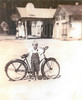 In the background, Sheboggy's Diner, Service Station  and Dance Hall, just east of Alapaha about 1936. Drew Rowe with bicycle. Photo courtesy of Velma McMillan