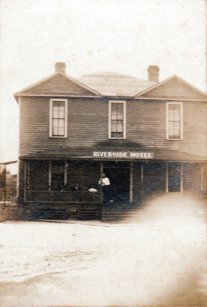 "This photo of the Riverside Hotel in Bannockburn, Georgia, was identified as ""Bannockbur Hotel—Phinnie"" written in three separate lines. The Hotel was probably built sometime around 1905 when the Massey Felton Lumber Company operated a sawmill on the west side of the Alapaha River, one mile east of Bannockburn. William K. Sikes and his brother Franklin went to work for the lumber company about 1908, and when the sawmill closed about 1910, they purchased the whole lot of 480 acres, including the hotel. <br /> Sometime shortly before 1935 the top floor of the hotel was removed, and the structure became one story with a small attic room. The Sikes children were reared in this structure throughout most of the childhood years. Photo courtesy of Elmer Keefe and William Outlaw. <br /> <a href=""http://www.southernmatters.com/image-database/display-selected.php?id=443"">http://www.southernmatters.com/image-database/display-selected.php?id=443</a>"