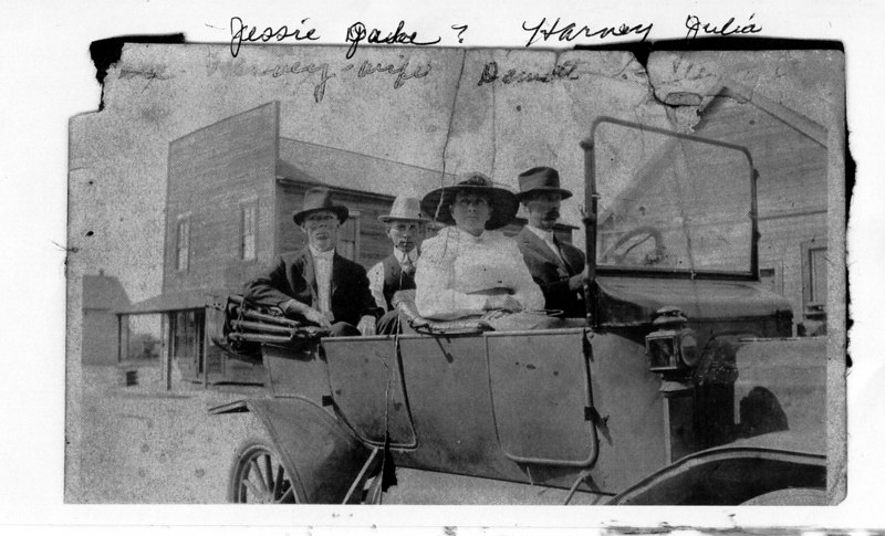 L-R:  Jessie Stewart, Jake Stewart, Julia Tucker Stewart, and Harvey Stewart  (downtown Enigma.  Jake Stewart was born 1899-2002, Harvey Stewart was Justice of Peace for many years in Enigma. Photo circa 1920's.