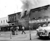 "Cohen's Fire – (July 9, 1953) – It took units from Nashville, Adel, and Moody Air Force Base three hours to bring a blaze under control that started in the upper story of the building owned by A.W. Gaskins according to an article in the July 16, 1953 edition of The Nashville Herald.  ""Firemen aimed streams of water at the two buildings on each side of Cohen's, a Firestone Store and Miller's Department Store, to protect them from damaging flames,"" reported the Herald.  It was reported in the article that the last big fire on the square was in 1940.  Although not mentioned by name, that would have been the Harvey's fire.  An interesting side note is that Cohen's burned again in 1966.(Courtesy: Skeeter Parker)"