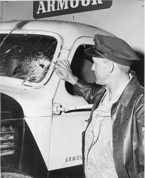 Armour Truck Strike Damage, March 1948<br /> (photo by Jamie Connell)<br /> <br /> The Nashville Herald, front page, April 8, 1948<br /> Photo caption:<br /> STRIKE TROUBLE – The Meat packer's strike extended here Wednesday of last week.  An Armour delivery truck from Tifton had a windshield smashed by bricks thrown from a passing automobile.  The driver, W.C. Harnage of Tifton, shown here was uninjured. – Photo by Jamie Connell.