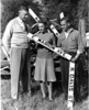 First street signs in Nashville, 1946. Left to right Bernys W. Peters, Margaret McLendon, Alton Futch.<br /> <br /> The Nashville Herald, front page, Thursday, October 24, 1946<br /> Photo caption:<br /> MARKERS FOR CITY'S STREETS<br /> Nashville has grown so much that it is bursting its seams.  Some residential sections have developed beyond present limits of the city mail service, so street signs are being placed to get extensions on the mail routes.  Bernys W. Peters, recently appointed postmaster, Margaret McLendon, clerk, and Alton Futch, navy vet who contracted to place the signs, inspect some of them.  Army vet, Aubra McKinnon, painted the markers.  – Photo from The Atlanta Constitution.  (Photo by Jamie Connell)(Courtesy: Skeeter Parker)