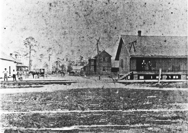 Town of Lenox, photo taken in 1905 looking west on Central Avenue. On the left is the cotton gin and store operated by John Richard Robinson. Behind it is the Joseph Daniel Robinson's home. On the right is the Lenox train depot, and the two story building is the Lenox Hotel operated by John E. Sears. Photo courtesy of Warren Robinson.