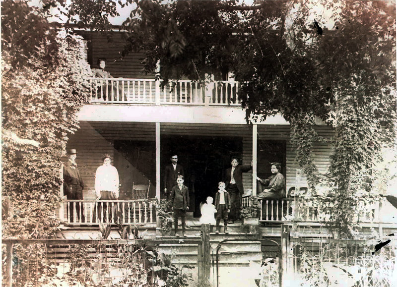 The George Howell house on today's Courthouse Square in Lakeland, was a stagecoach stop in the 1890s. Pictured left to right: John W. Berryhill, Mrs. George Howell, George Howell, Frank Howell, Burrell Howell, Jim Howell, Tom Howell, and Nesie Howell.